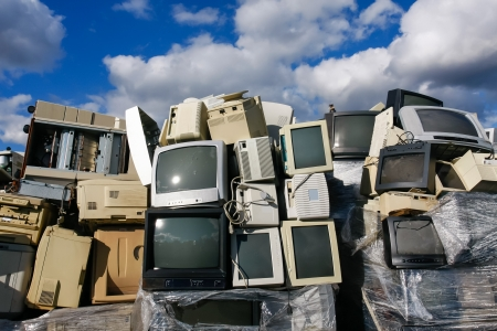 junk: Junked crts computer monitors, tvs and old printers for recycling or safe disposal recycling, any logos and brand names have been removed. Great for recycle and environmental themes.