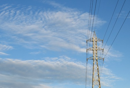 amp tower: High tension electrical power lines and pylon tower against sky. Modern industrial energy line.