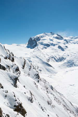 snow covered mountain: Winter snow covered mountain peaks in Switzerland