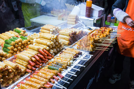 Korean street food at Myeong-Dong night market, many meat ball skewers look delicious Stock Photo