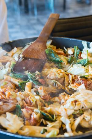 turner: Korean spicy stir fried vegetable, chicken and Korean spicy sauce (Gochujang) in big hot pan know as Dak Galbi