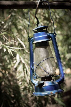 luminance: old lamp hang on wood in countryside Stock Photo