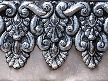 craftmanship: art on aluminium wall , thai craftmanship at temple