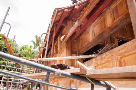 new construction renovation: struction of new monks house in countryside of thailand made of wooden and mortar