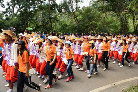faculty: Chiang Mai, Thailand - September 12, 2015: student from Faculty of Nursing in Chiang Mai university CMU  walk for show spirit in Freshmen Welcoming Ceremony of CMU at Doi suthep temple on September 12, 2015 in Chiang Mai, Thailand.
