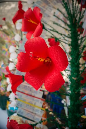 merit: Thai people made colorful artificial flowers decorate money tree to merit for temple