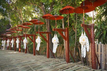 lanna: paper lantern lanna lamp decoration under umbrella at temple in Loy Krathong Day 2015, thailand
