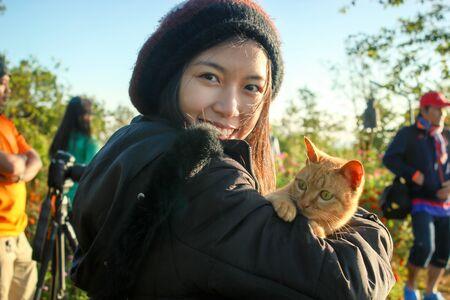 naughty girl: naughty girl hold naughty cat in the morning