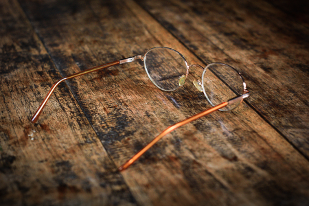 olds: Olds glasses on old wooden table