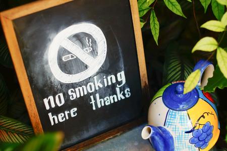 statute: No smoking in the garden and restaurant Stock Photo