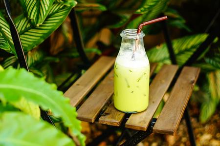 relax garden: iced green tea  on chair in relax garden corner