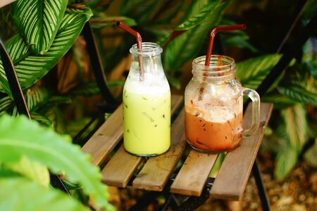 relax garden: iced green tea and cocoa on chair in relax garden corner Stock Photo