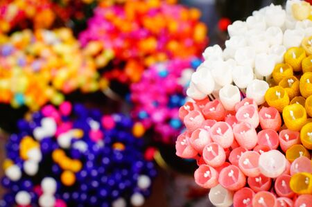soft sell: colorful artificial flowers made of cocoon in Thai land