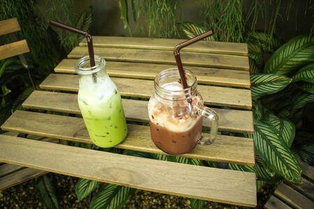 relax garden: cocoa and green tea  on table in relax garden