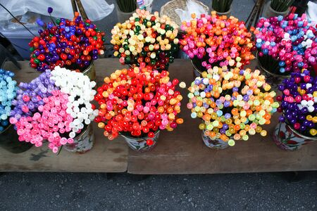 material flower: colorful artificial flowers made of cocoon in Thai land