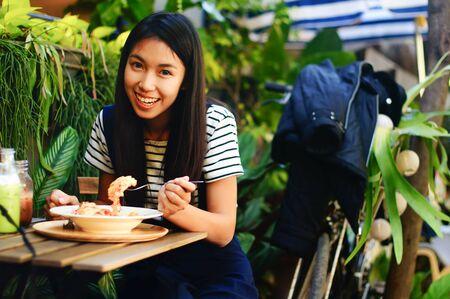 breakfast garden: Girl has breakfast in the beautiful garden