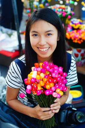 soft sell: colorful artificial flowers made of cocoon in Thailand Stock Photo