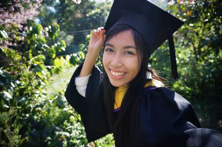 faculty: graduated selfie and smiling in forest, she studies biology in Faculty of science  from thai university Stock Photo