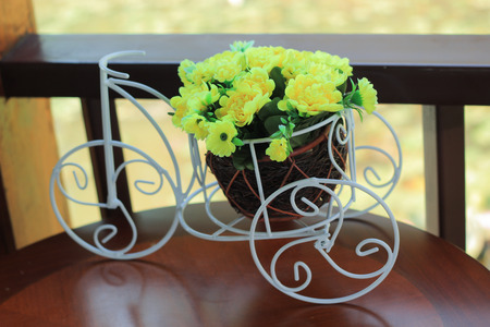 mini bike: Vintage bicycle toy for decoration with artificial flowers on table