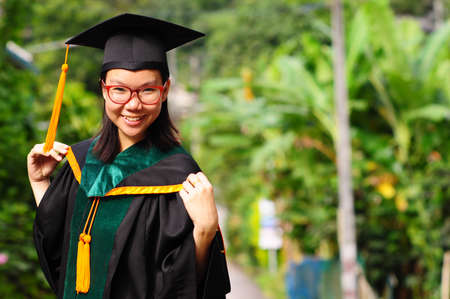 graduate students: Asian graduated girl at countryside