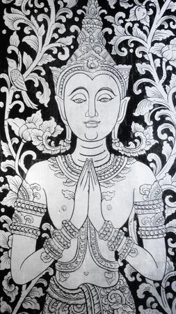 deity: deity grawing on thailand temple door Stock Photo
