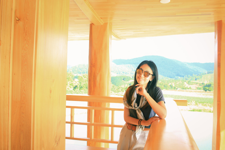 Woman in japanese wooden room at Hinoki land Chiang Mai, Thailand. New Attractions for travel far away from city. This place have beautiful red poles row, castle and garden resemble and same japanese