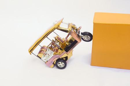 Tuk Tuk -  Thailand taxi model, mini toy on isolated white background 写真素材