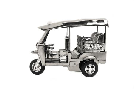 Tuk Tuk -  Thailand taxi model, mini toy on isolated white background Standard-Bild