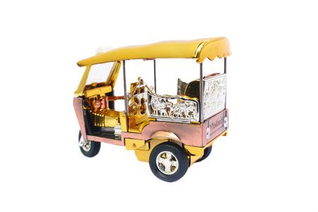 Tuk Tuk - Thailand taxi model, mini toy on isolated white background