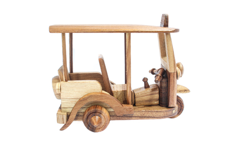 Wooden Tuk Tuk - Thailand taxi model for souvenir and Decoration. Three-Wheels photo on isolated white background.