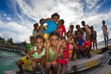 papua: The kids of Arborek villageRaja Ampat Indonesia.They are so friendly and live in the most peaceful place in the world.