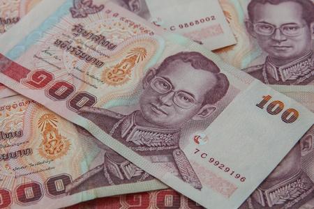 one hundred thai baht banknotes photo