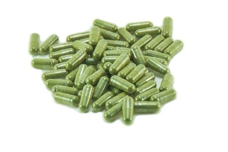 Capsule pills on white background, green capsule pills photo