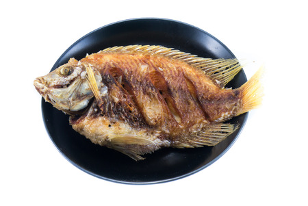 tilapia Fish fried in the dish, Fish fried isolated photo