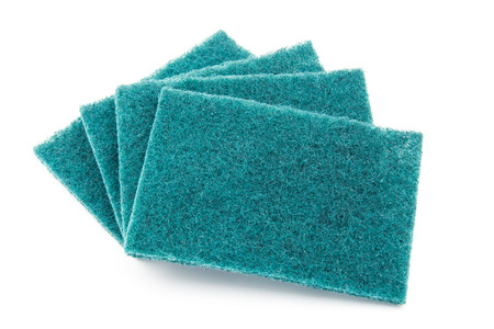 several sheets of scrub sponge on white background
