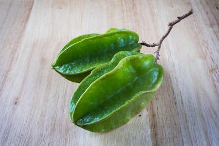 carambola: Carambola (Averrhoa carambola) on wood background