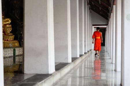 walk in: A monk walk in a temple(Wat) in peaceful moment ,Bangkok,Thailand. Editorial