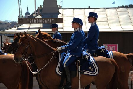 Sweden Stockholm street house trees horse people police guard trooper
