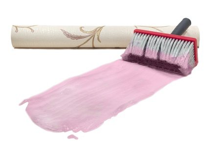 Brush for gluing of wall paper trail of the pink glue roll beige wallpaper texture isolated on white background photo