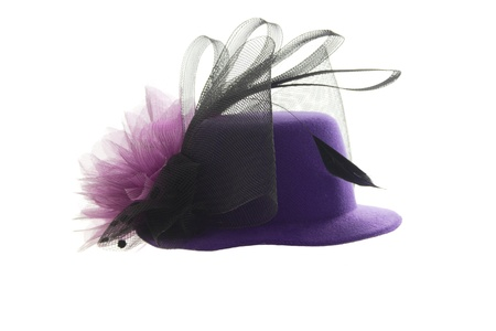 Lilac womens hat with a pink bow and black feathers photo
