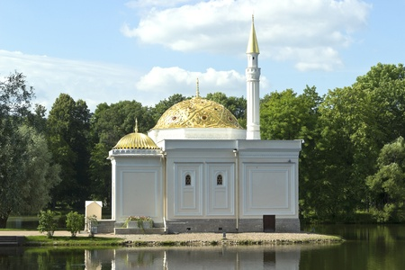Turkish bath on the lake shore in the Catherine Park sky clouds gold dome water photo