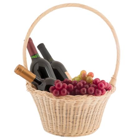 Bottle basket  wine grapes glass isolated white background Stock Photo