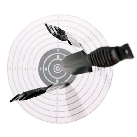 Knives target fly direct goal black red white insulated  background photo