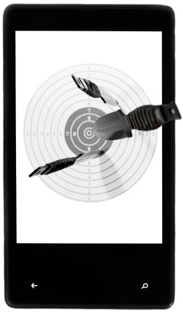 Target throwing knives screen smartphone black white background isolated photo