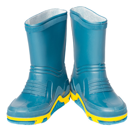 kids rubber boots green blue red yellow rag insert isolated white background photo