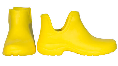 rubber boots yellow rag insert isolated white background photo