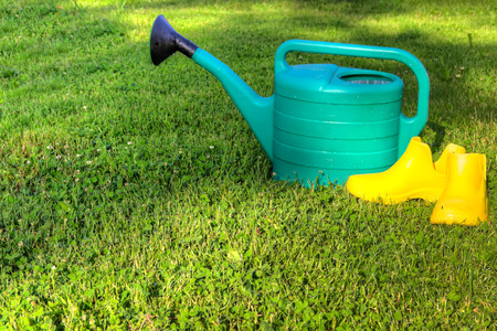 wellie: watering flexible tube grass yellow rubber boots hdr