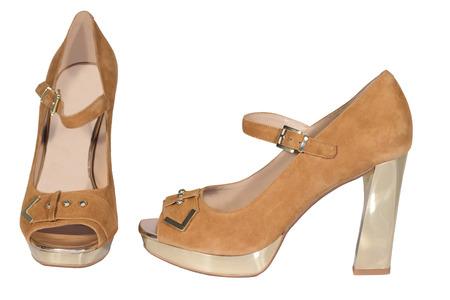 zapatos de tac�n alto para mujer de color beige fondo blanco aislado photo