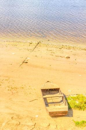 dikes: old boat shore  river sky sand beach Stock Photo