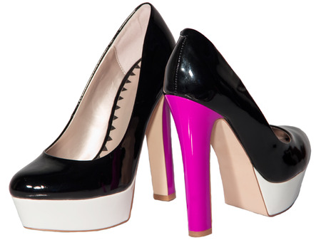 patent leather: Womens shoes black patent leather pink high heel sole white isolated background one pair